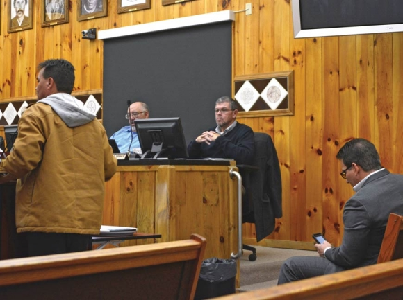 Former Principal Chief Patrick Lambert (left) tells Tribal Council his concerns about the payouts as Principal Chief Richard Sneed (far right) sits in the front row of Council chambers in January. File photo