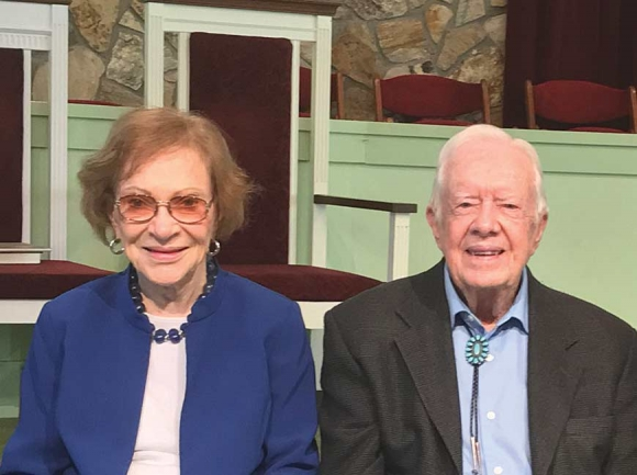 President Jimmy Carter (right) and wife Rosalynn sit in the sanctuary at Maranatha Baptist Church in Plains, Ga. Cory Vaillancourt photo