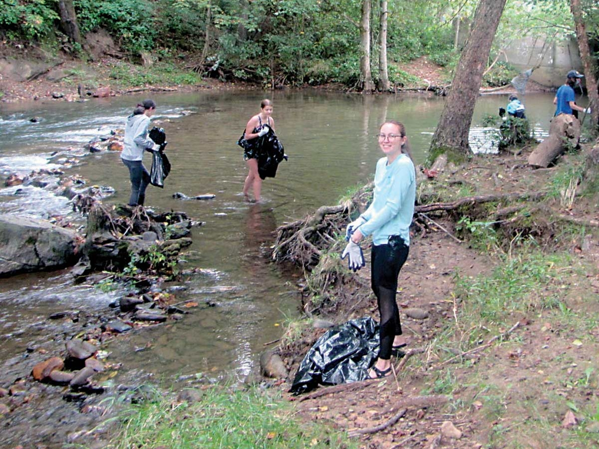 Students from Haywood Community College and Haywood Early College collect trash in Richland Creek. Haywood Waterways Association photo