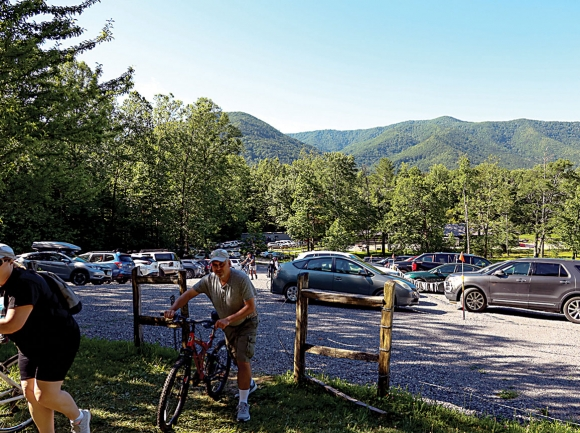 Cyclists leave the newly improved parking area to cruise Cades Cove. NPS photo