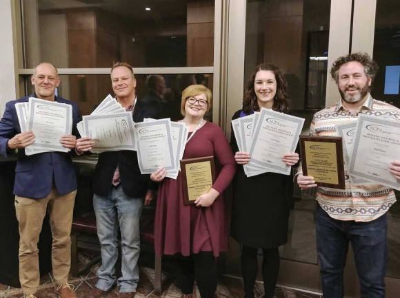 Smoky Mountain News staff (from left) Scott McLeod, Cory Vaillancourt, Jessi Stone,      Holly Kays and Garrett K. Woodward stop for a photo at the NCPA awards ceremony in Raleigh on Feb. 27. Donated photo