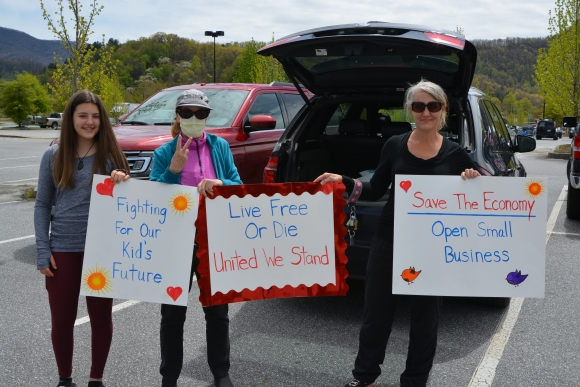 A group of protestors prepare to drive across Haywood County on April 19.