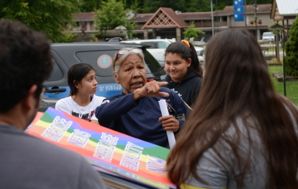 Yellowhill community member Mary Crowe speaks with LGBTQ advocates outside the Cherokee Council House July 8, following Tribal Council's second refusal to consider an ordinance legalizing same-sex marriage. Holly Kays photo