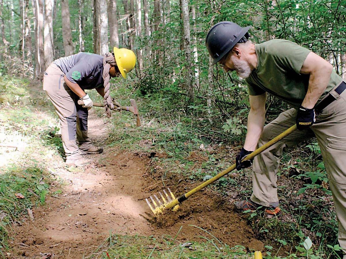Volunteers work to repair trail tread. NPS photo
