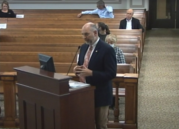 Haywood County Program Administrator David Francis explains the county's new economic development policy to commissioners May 18.