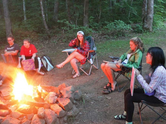 Girls gather around a bonfire for some end-of-day activities. Donated photo