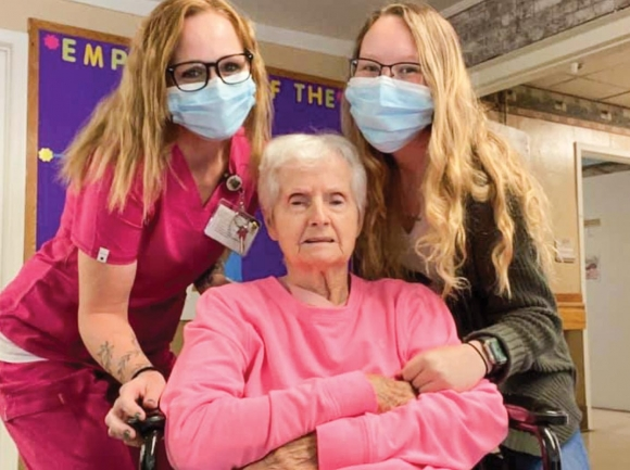 Skyland Care Center staff members pose for a picture with a resident.