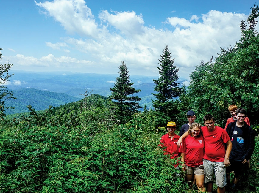Teens explore the mountains during a summer adventure camp. Tremont photo