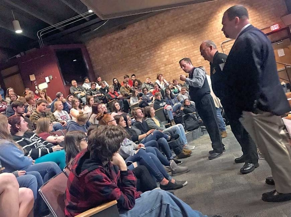 Swain County High School Principal Mark Sale (from left) Sheriff Curtis Cochran and Assistant District Attorney Jason Arnold speak to students about the seriousness of making threats at school. Jessi Stone photo