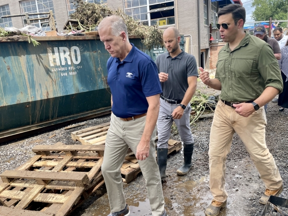 Sen. Thom Tillis (left) looks over damage at BearWaters Brewing with Canton Town manager Nick Scheuer (center) and Mayor Zeb Smathers (right).