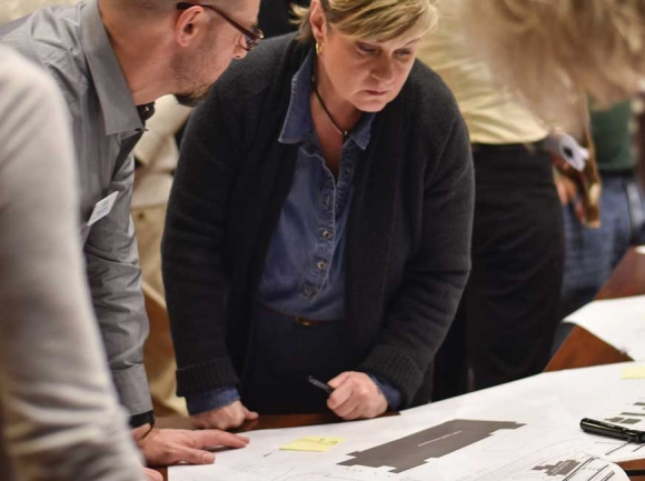 Asheville Design Center Director Chris Joyell, left, talks to community members during a Jan. 14 meeting. Holly Kays photo