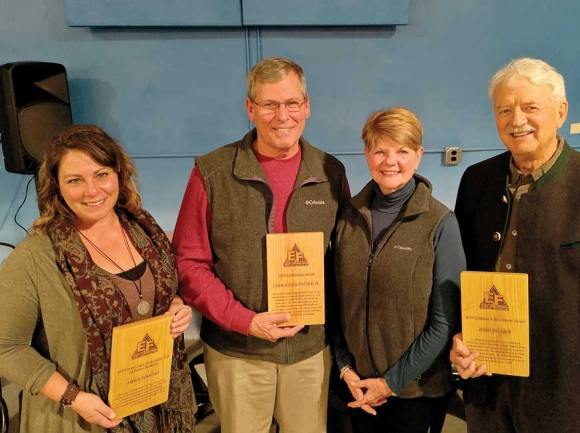 Retired Haywood Community College forestry instructor John Palmer (right) received the 2019 EcoForesters Root Cause Lifetime Achievement Award, with Aimee Tomcho of the Audubon Society (left) winning the Sustainable Use of Forest Products Award and landowners Linda and Ellis Fincher receiving the EcoForester of the Year Award. Donated photo