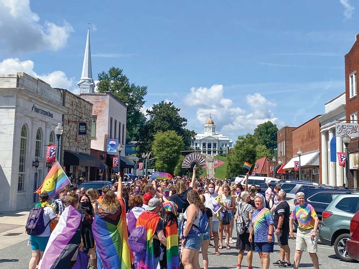 Pride Parade participants march down Main Street in Downtown Sylva. Hannah McLeod photo