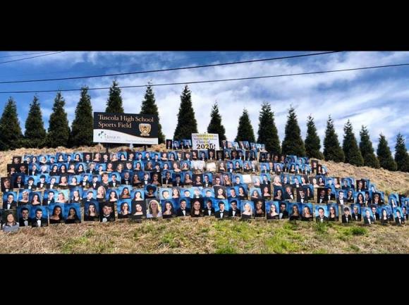 Graduate photos dot the hillside below Tuscola High School. Donated photo
