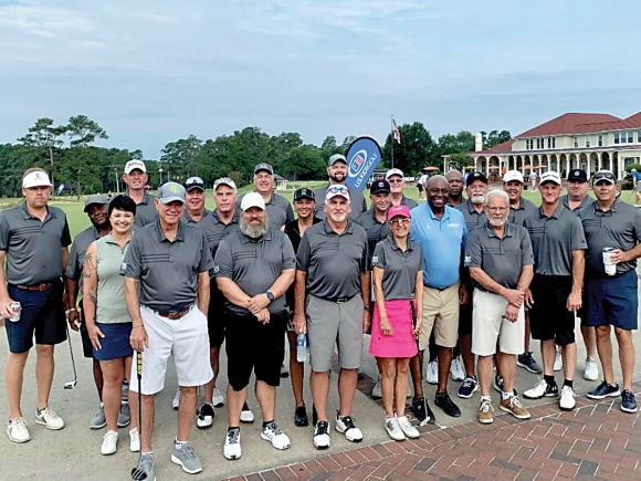 Team Members of Harrah's Cherokee Casinos join Phil Ford, honorary chairperson of N.C. Beautiful and former North Carolina Tar Heel basketball player and coach, for a group photo during the 35th Annual Golf Classic. Donated photo