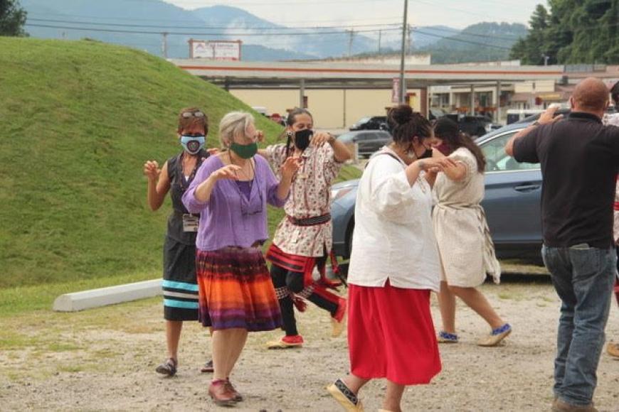 Nikwasi Initiative Executive Director, Elaine Eisenbraun, joins the Cherokee Culture Keepers in Bear Dance to celebrate groundbreaking at new Kiosk site.