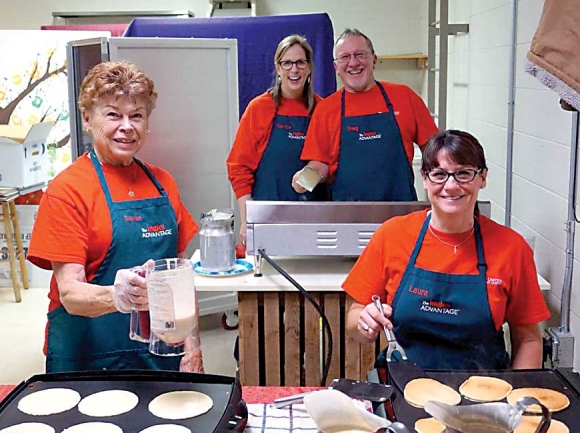 Volunteers prepare pancakes at First United Methodist Church of Waynesville. Donated photo