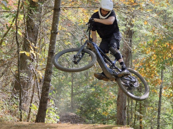 A biker takes a jump at a bike park similar to the one Asheville YouTuber Seth Alvo is building within Canton's Chestnut Mountain Park. Seth Alvo photo