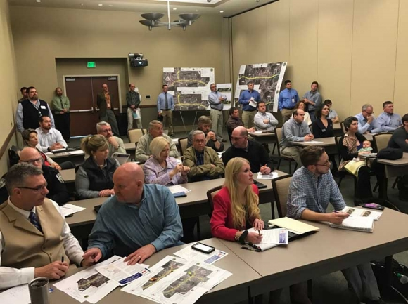 Town and county leaders gather for an information session on the N.C. 107 project in 2017. SMN photo