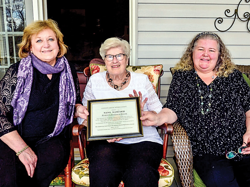 Roberta Swank (middle) is presented with the 2021 Macon Matriarch Award from Women's History Trail members Anne Hyder (left) and Claire Claire Suminski. Karen Lawrence photo
