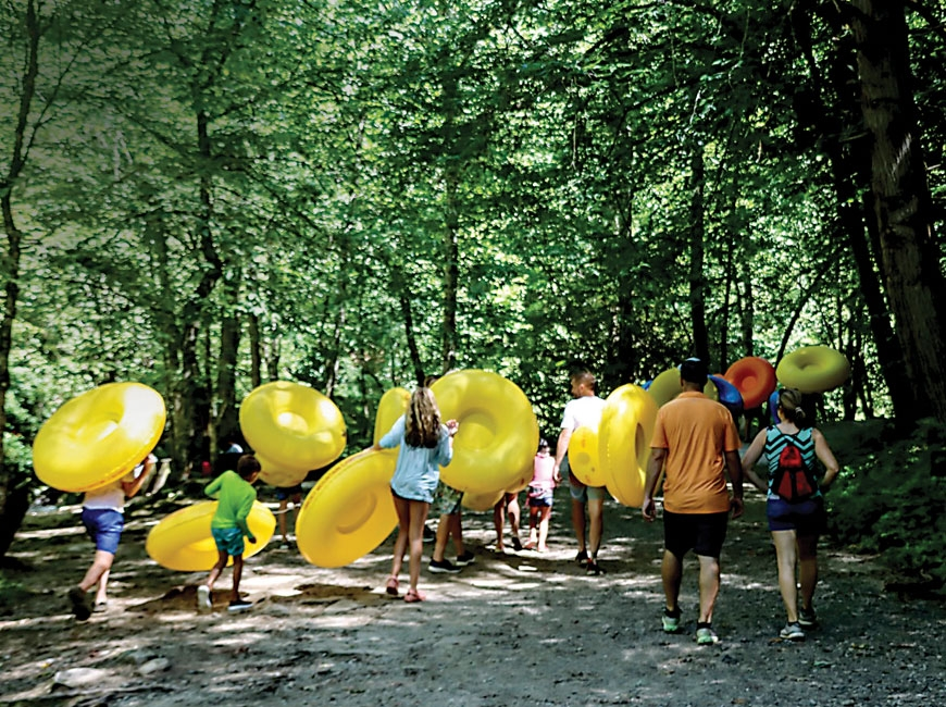 Tubers walk the path at Deep Creek, which has seen an enormous increase in usage this year. NPS photo
