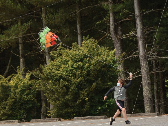 A camper tests out the tetrahedral kite he'd tinkered with throughout the two-week camp. Holly Kays photo
