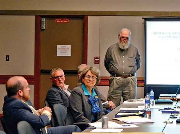 TWSA Executive Director Dan Harbaugh (standing) updates Jackson County Commissioners on research into the potential for a Cashiers water system. Holly Kays photo