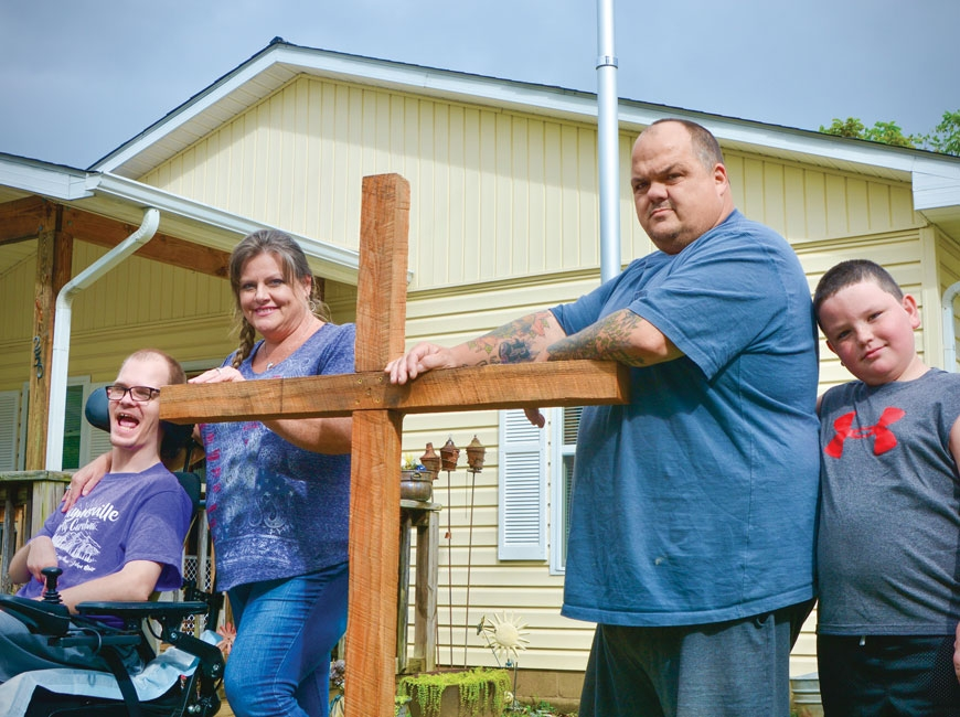 The Barnette family (left to right) Joshua, DJ, Darrell and Zander, stand outside their Hazelwood home. Cory Vaillancourt photo