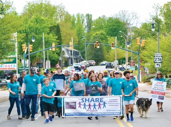 Nearly 200 people took part in a May 16 march in Waynesville, hoping to end the stigma surrounding drug abuse.