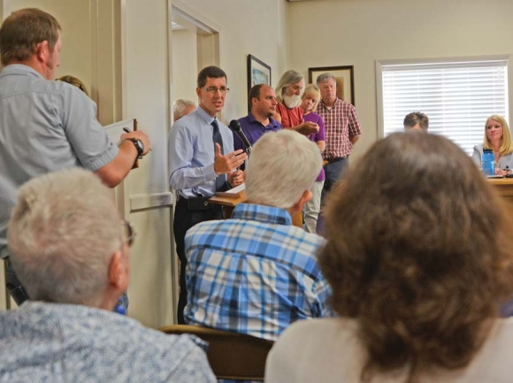 DOT engineer Brian Burch discusses the N.C. 107 project to a more-than-full room at Sylva Town Hall. Holly Kays photo