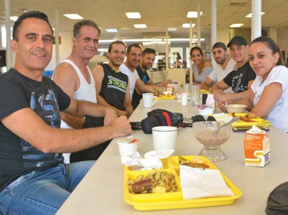 Members of the Kyrenia Youth Centre Association enjoy breakfast at Folkmoot July 23. Cory Vaillancourt photo