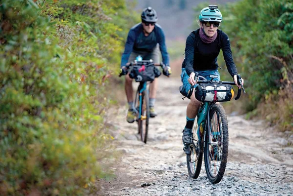 A pair of cyclists cruise WNC trails riding bikes outfitted with parts made by Asheville-based company Industry Nine.