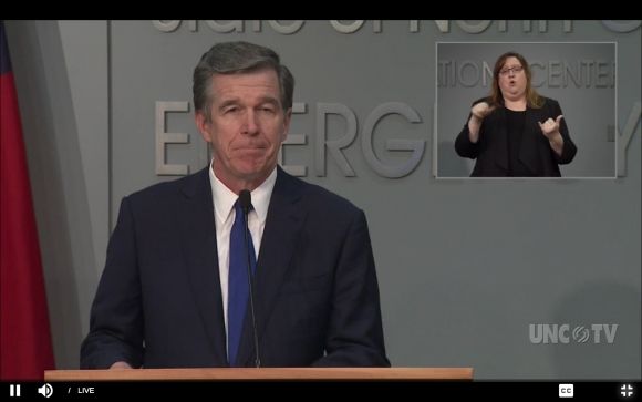 Gov. Roy Cooper (left) holds a press conference on May 20.