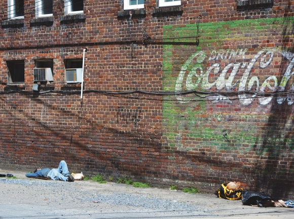 A man takes a nap in an alley in Frog Level on the afternoon of April 18. Cory Vaillancourt photo