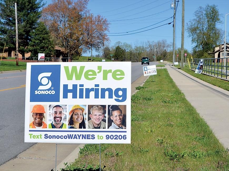Signs outside Waynesville's Sonoco Plastics promote a hiring fair in April, 2020. Cory Vaillancourt photo
