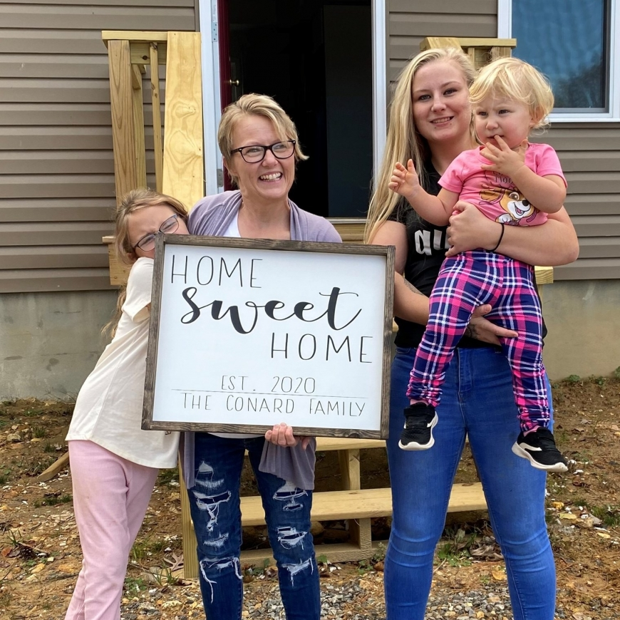 The Conards celebrate the dedication of their new Habitat home