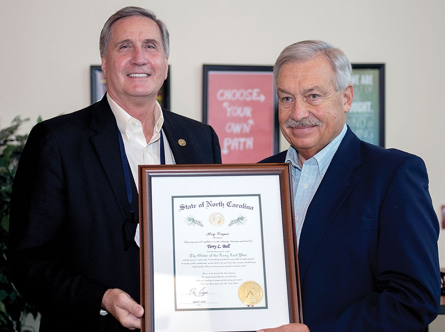 Terry Bell (right) receives The Order  of the Long Leaf Pine from SCC President Dr. Don Tomas.