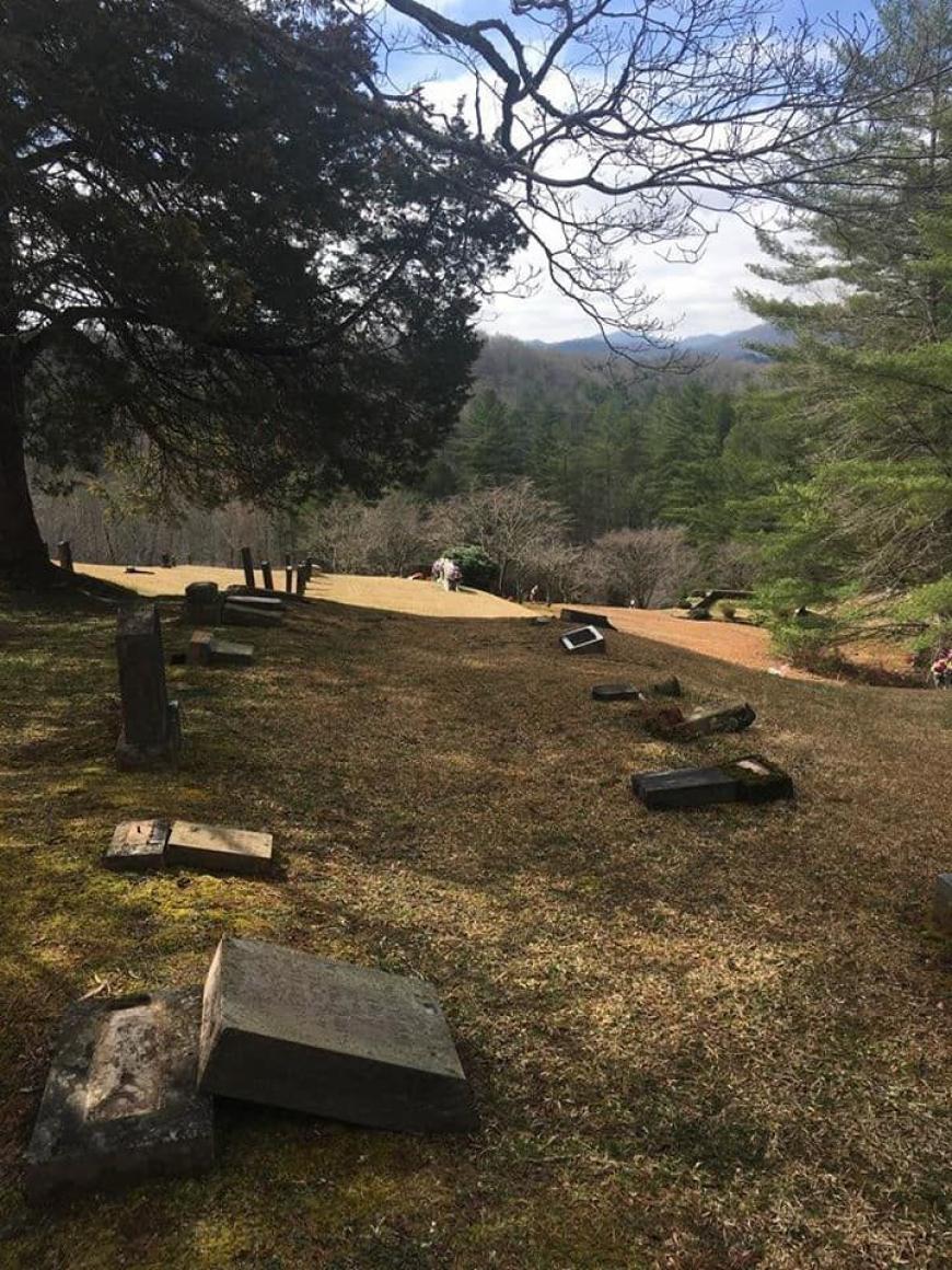 Woman dismissed for overturning gravestones