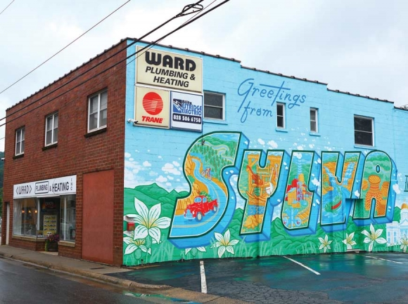 The mural on the Ward Plumbing & Heating Building on Mill Street in downtown Sylva. (photos: Garret K. Woodward)