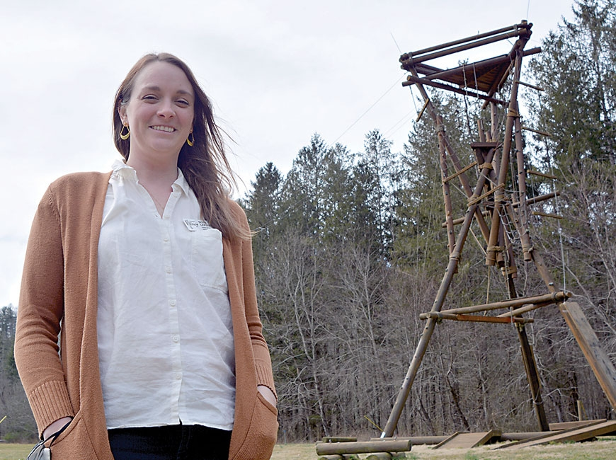 Jessi LeFiles, executive director of Camp Henry, stands before the camp's Alpine tower. Cory Vaillancourt photo