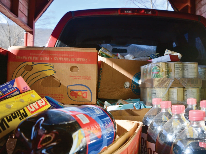 The back of Beverly Banks' big red truck is full of groceries donated to the Open Door, in Frog Level. Cory Vaillancourt photo