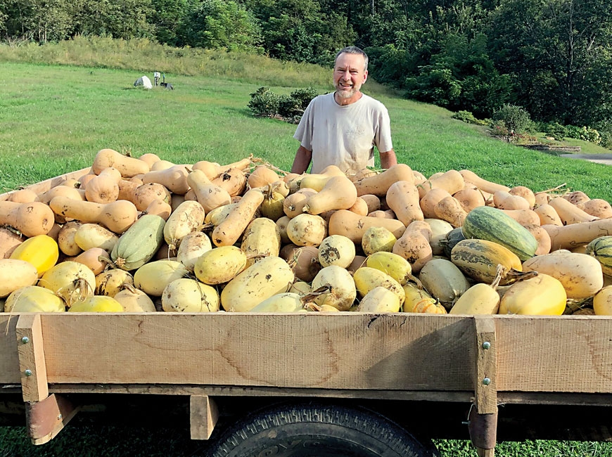 Don Carringer poses with the winter squash harvest he brought in at Carringer Farms in Macon County. ASAP photo