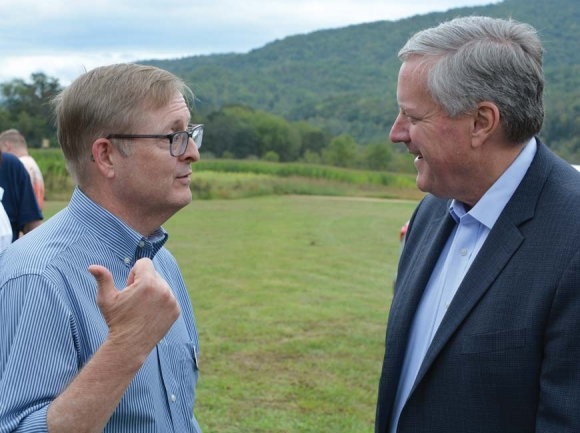 Judicial candidate Jim Moore (left) talks with Rep. Mark Meadows Oct. 12 at a Swain County GOP fundraiser. Cory Vaillancourt photo.