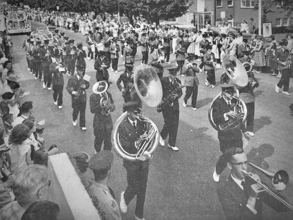 Sponsored by the Canton Lions Club, the Canton High School band marches in the 1957 Canton Labor Day parade.