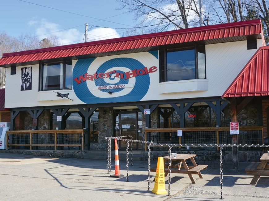 The Water'n Hole in Waynesville will soon celebrate 15 years in operation as the final frontier of the beloved 'dive bar' in our region. (photos: Garret K. Woodward)