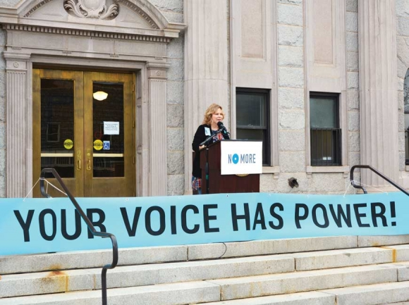 Haywood County Domestic Violence Task Force Member Buffy Queen addresses a rally April 25 outside the Haywood County Historic Courthouse. Cory Vaillancourt photo