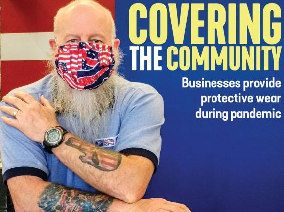 Cory Edwards, a U.S. Postal Service employee at the Waynesville Post Office, wears a mask made by a local seamstress. Mandy Wildman photo