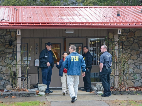FBI agents take documents from the Qualla Housing Authority headquarters during a February 2017 raid. Holly Kays photo