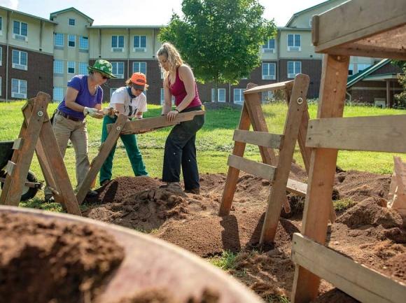 Participants in WCU's summer archeology field school work on the Norton Field site. WCU photo