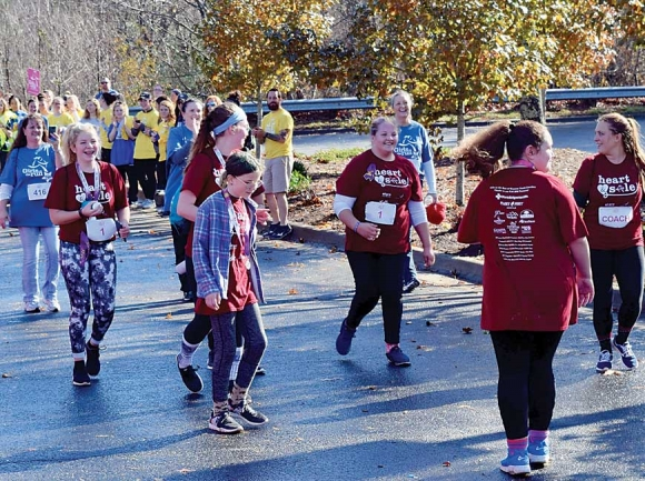 Jaylyn Logan, an eighth-grader at the new Catamount School in Sylva, approaches the finish line of the Girls on the Run 5K race with her teammates in December. Donated photo